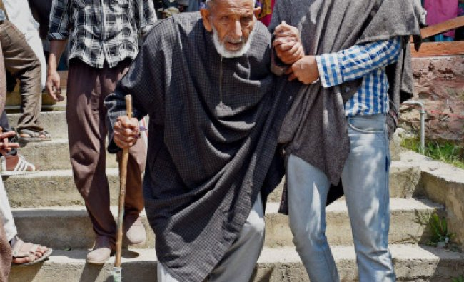 Kupwara : 90-year old Ghulam Ahmad Tantray coming out of a polling booth after casting his vote...