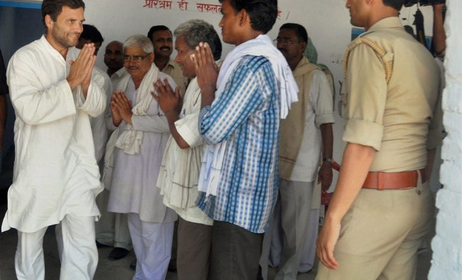 Rahul Gandhi interacts with voters near a polling booth in Amethi on the voting day ...