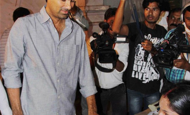 Cricketer and Congress candidate Mohd. Kaif gets his finger inked before casting his vote ...