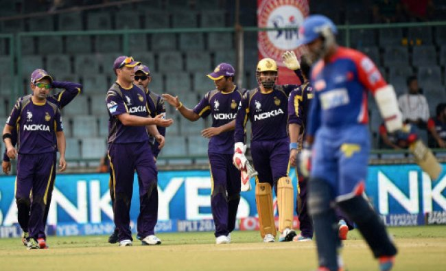 Kolkata Knight Riders players celebrate wicket of Delhi Daredevils\' Dinesh Karthik during their...
