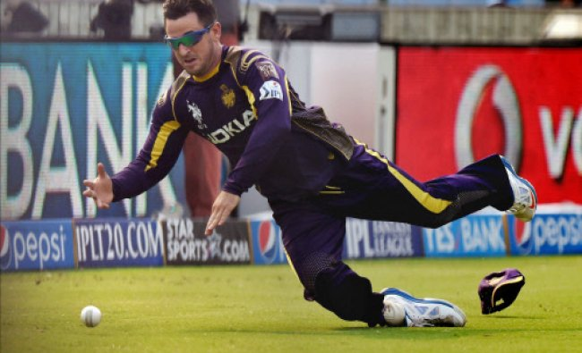 Kolkata Knight Riders player Ryan Ten Doeschate dives to stop the ball during their IPL 7 match...