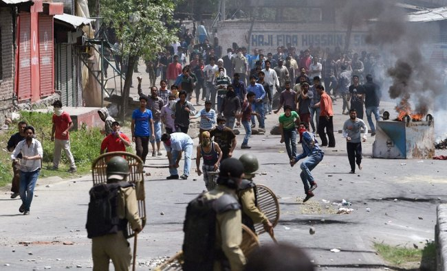 Residents of Saidakadal pelt stones on security forces during a protest in Srinagar ...