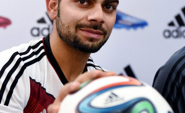 RCB cricketer Virat Kohli looks on during an event of FIFA Flag Bearers 2014 in Bengaluru ...
