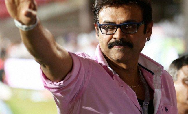 Telugu Star Venkatesh waves to his fans during the IPL 7 match against RCB in Bengaluru ...