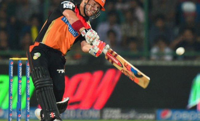Sunrisers Hyderabad batsman David Warner plays a shot during the IPL 7 match against Delhi...