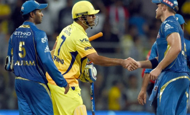 M S Dhoni of the Chennai Super Kings being greeted by Mumbai Indians players after the victory...