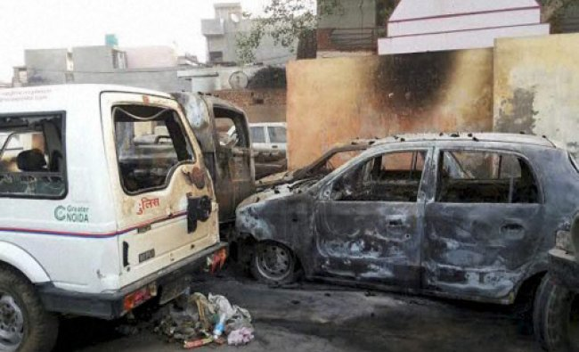 Burnt vehicles which were set ablaze by a mob at police beat in Greater Noida...