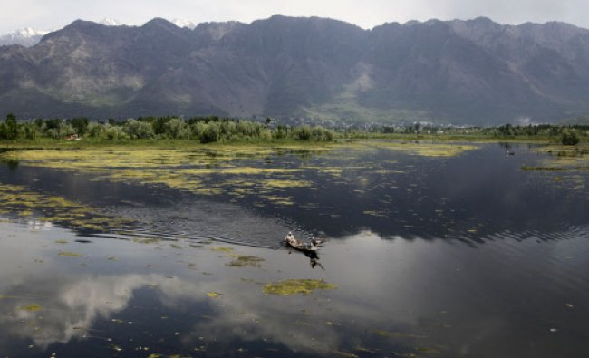 A couple rows their boat in the waters of Nigeen Lake on the outskirts of Srinagar. Set in the...