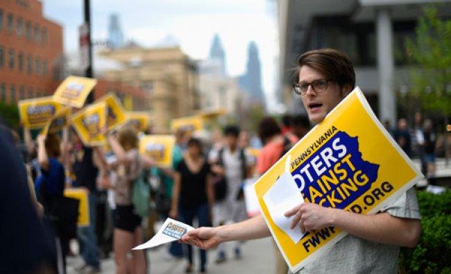 Anti-fracking protestors gather outside the final debate among the democratic gubernatorial...