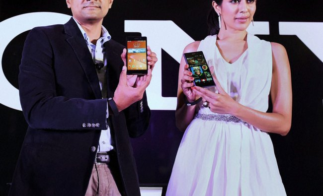 Sachin Rai, Business Head, Xperia, Sony India with a model at the launch of Experia Z2 ...