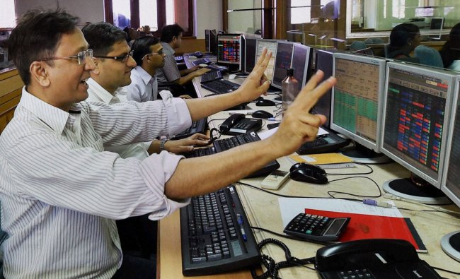 A stock broker reacts as the Sensex crosses the 24,000 ponits mark at Bombay Stock Exchange ...