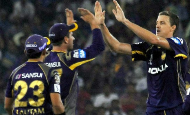 Kolkata Knight Riders players celebrate after dismissal of a wicket of Mumbai Indians during...