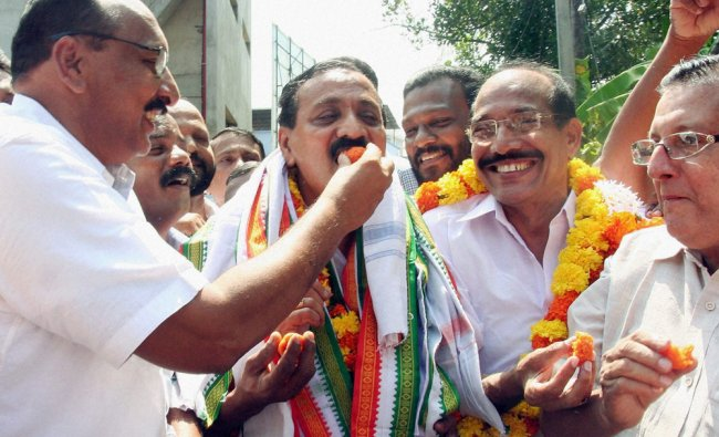 Congress workers offer sweets to MK Ragavan for his win in Kozhikode, Kerala ...