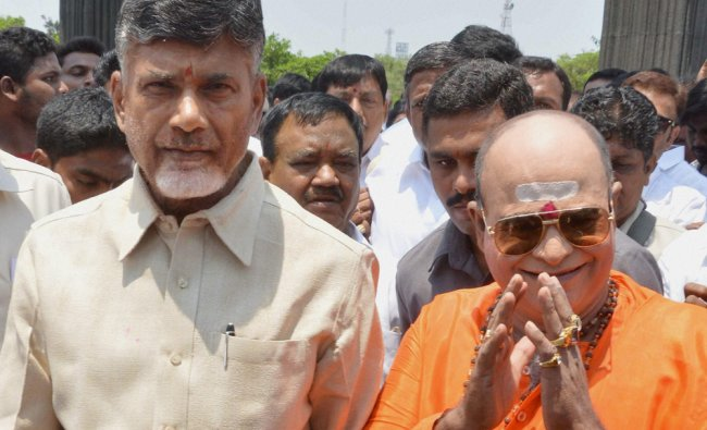 TDP President N Chandra Babu Naidu with a TDP worker at NTR Ghat in Hyderabad ...