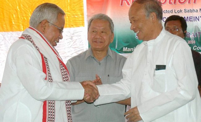 Chief Minister of Manipur Okram Ibobi Singh felicitates Thokchom Meinya during a reception ...
