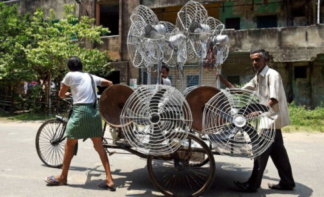 Peoples carrying fans during a hot day in Kolkata...