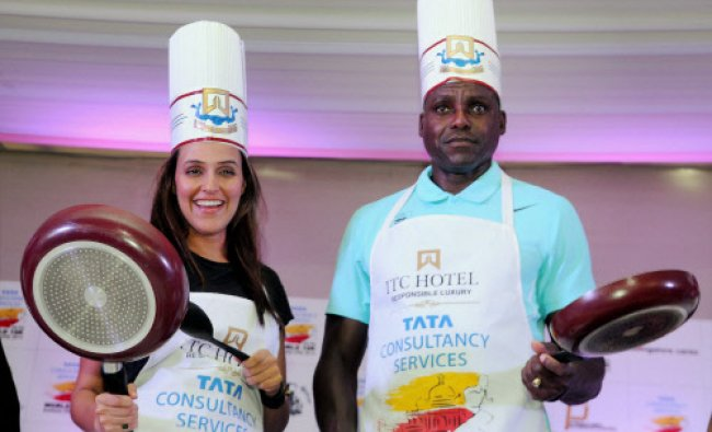 Former International athlete Carl Lewis with actor Neha Dhupia during the pasta party...