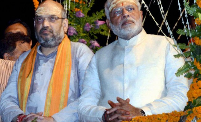 BJP leader and the next Prime Minister Narendra Modi with party leader Amit Shah attend...