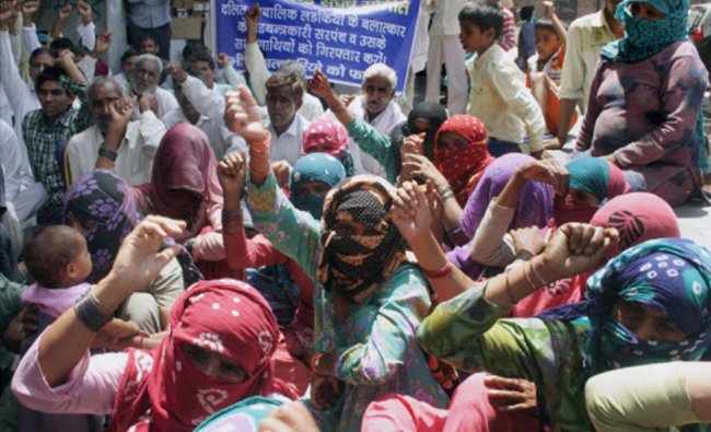 Dalit community people and AISA students protest over the rape of a dalit girl in Bhagana...