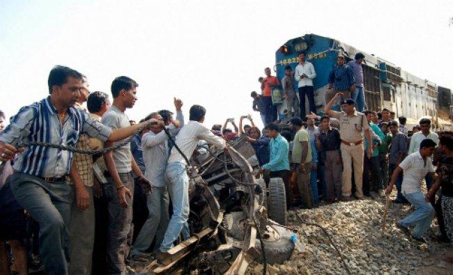 Rescue work at an unmanned railway crossing where a train hit a mini truck at Sandiyavadi...