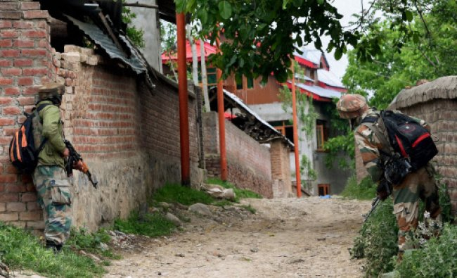 Soldiers during their house-to-house search operation after a militants\' attack at Chadoora...