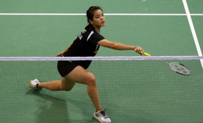 Malaysia\'s Lim returns a shot to Denmark\'s Jensen during their women\'s singles match at the Uber...