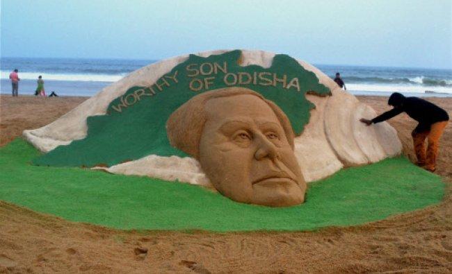 Sand artist Sudarsan Pattnaik creates a sand sculpture of Odisha Chief Minister Naveen Patnaik...
