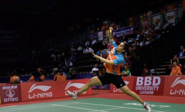 India\'s Saina Nehwal plays a return to Pui Yin Yip of Hong Kong China during their Thomas...