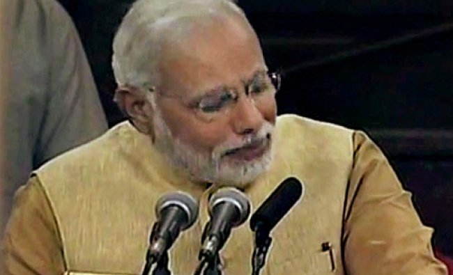 Prime Minister-elect Narendra Modi gets emotional while addressing the BJP parliamentary ...