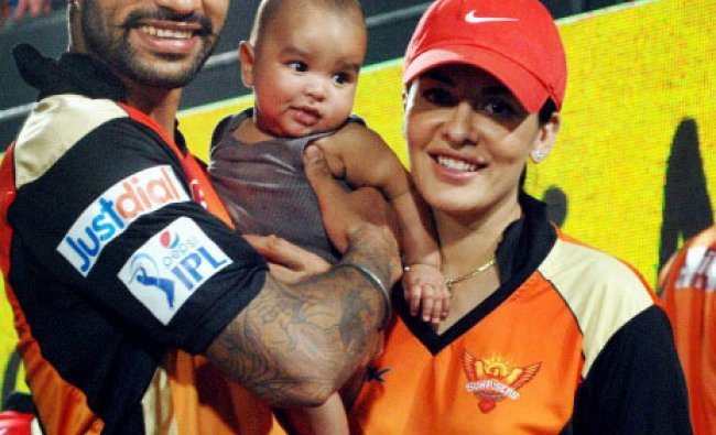 Shikhar Dhawan with wife Ayesha and their son at the IPL 7 match between Royal Challengers ...