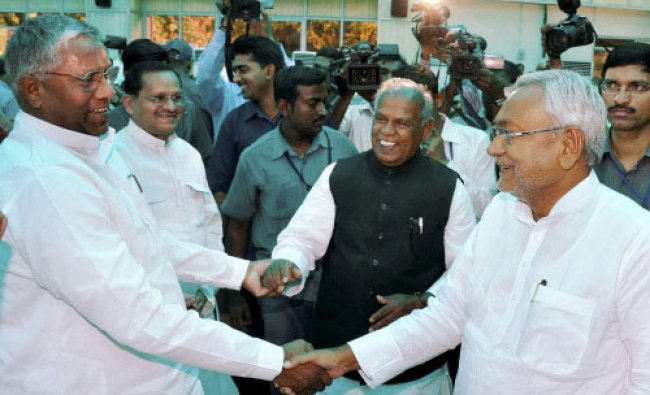 Speaker Uday Narayan Chaudhary greets Bihar\'s new Chief Minister Jitan Ram Manjhi and ...