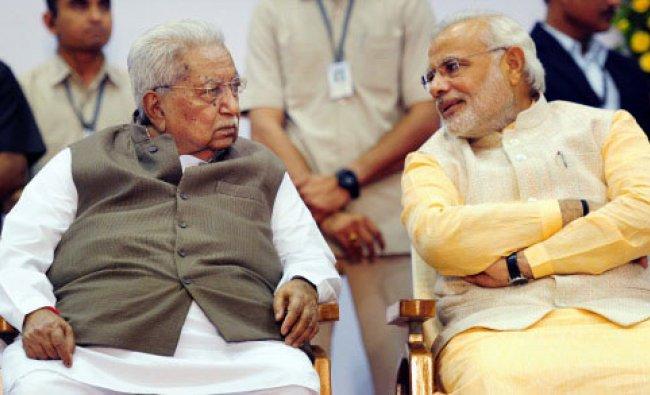 Prime Minister-elect Narendra Modi with veteran leader Keshubhai Patel during the swearing-in ...