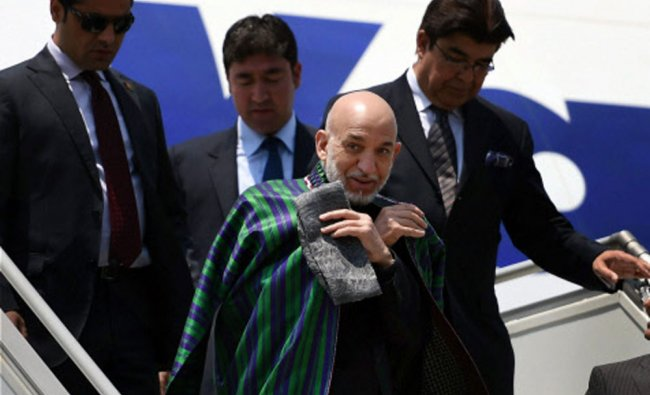 Afghanistan President Hamid Karzai arrives at AFS Palam to attend the swearing-in ceremony of...