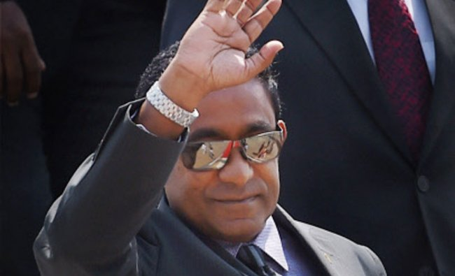 Maldives President Abdulla Yameen waves upon his arrival at AFS Palam to attend the swearing-in...