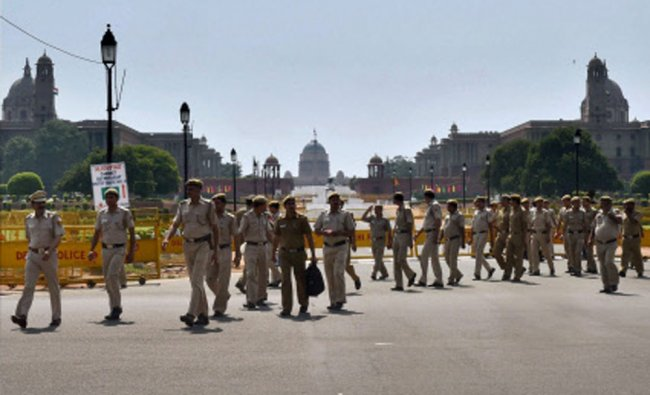 Security personnel guard at Rajpath that was closed for the public due to Narendra Modi-led NDA...