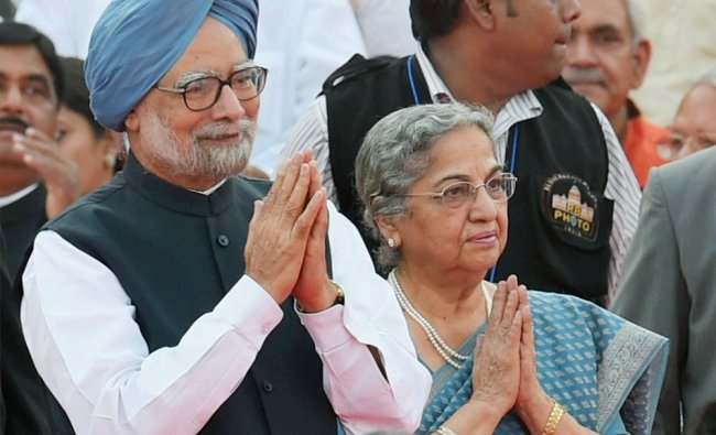 Outgoing Prime Minister Manmohan Singh and his wife Gursharan Kaur at the swearing-in ceremony ...