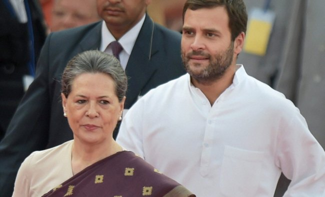 Sonia Gandhi with party vice president Rahul Gandhi at the swearing-in ceremony ...