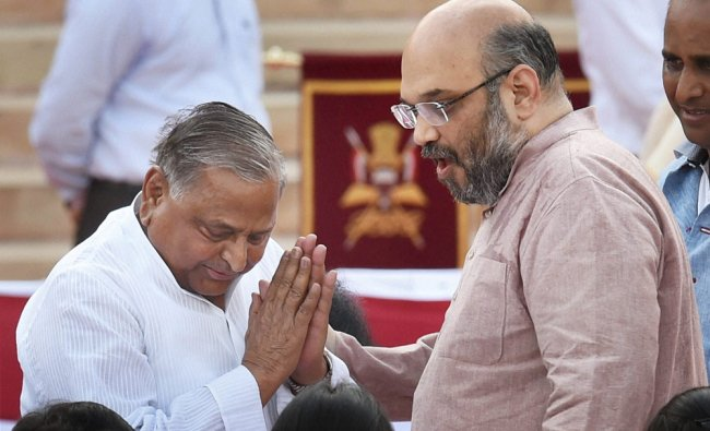Amit Shah and SP chief Mulayam Singh Yadav at the swearing-in ceremony of the NDA government ...