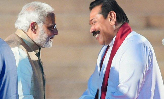 Newly sworn-in Prime Minister Narendra Modi is greeted by Sri Lankan President Mahinda Rajapaksa ...