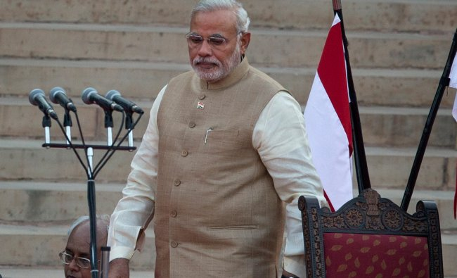 Narendra Modi, arrives to take the oath of office at the presidential palace in New Delhi ...