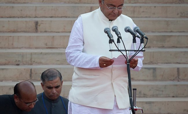 Cabinet Minister Arun Jaitley takes the oath of office at the presidential palace in New Delhi ...