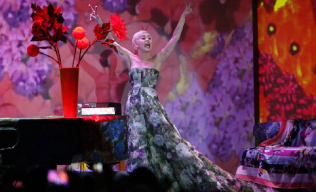 Singer Miley Cyrus performs before receiving an award during the World Music Awards in Monte...