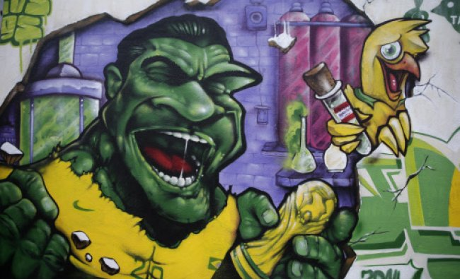 A wall decorated with a mural depicting Brazilian soccer player Hulk, stands in Rio de Janeiro...