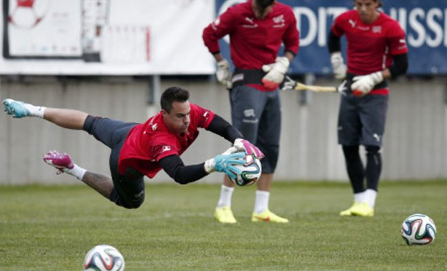 Diego Benagli, Roman Buerki and Yann Sommer, practice during a training session of the Swiss...