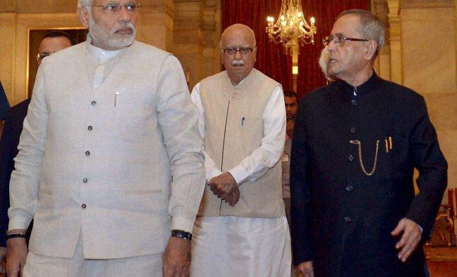 Pranab Mukherjee with Prime Minister Narendra Modi and L K Advani during the dinner ...