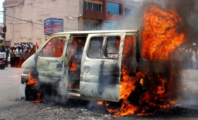 A car catches fire in Gurgaon on Wednesday...