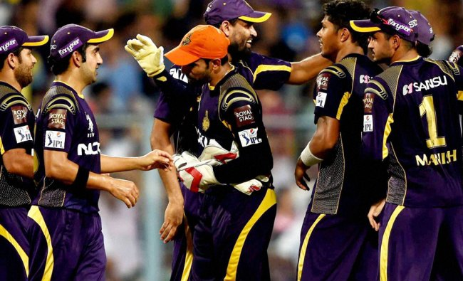 KKR players greet each other after winning IPL play off match against KXIP in Kolkata ...