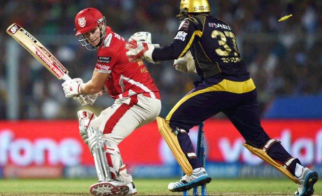 KXIP batsman DA Miller is bowled out during 1st IPL Play off match against KKR ...