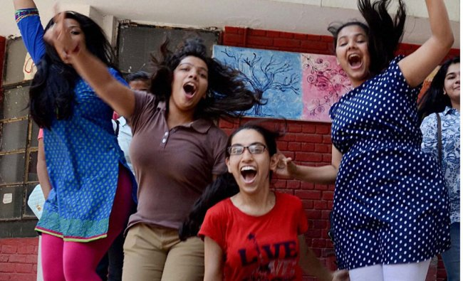Students celebrate their success after announcement of CBSE class 12th results in New Delhi ...