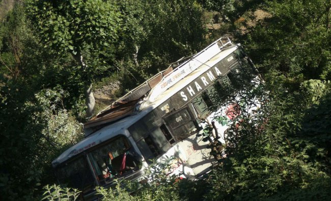 A passenger bus that rolled down into a deep gorge near Chilli, 65 km from Chamba ...